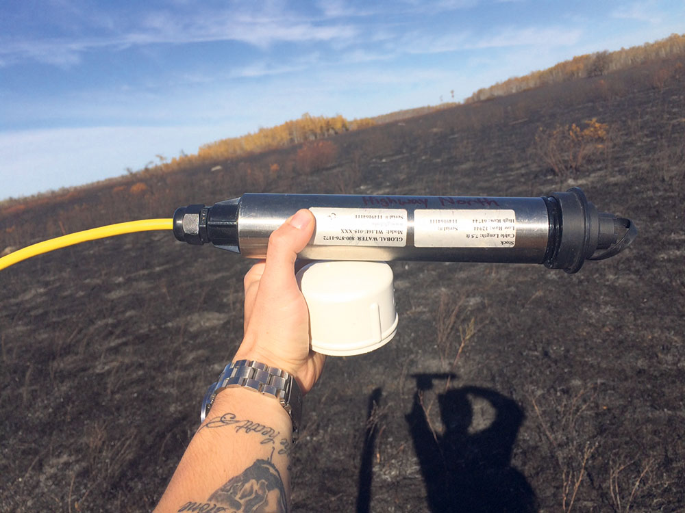 Data logger used to measure the height of groundwater following a prescribed burn on the tall grass prairie. NCC