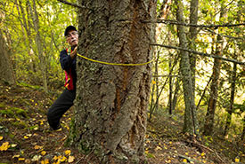 Dave Wickstrom measuring trees on the Midgeley property (Photo by Steve Ogle)