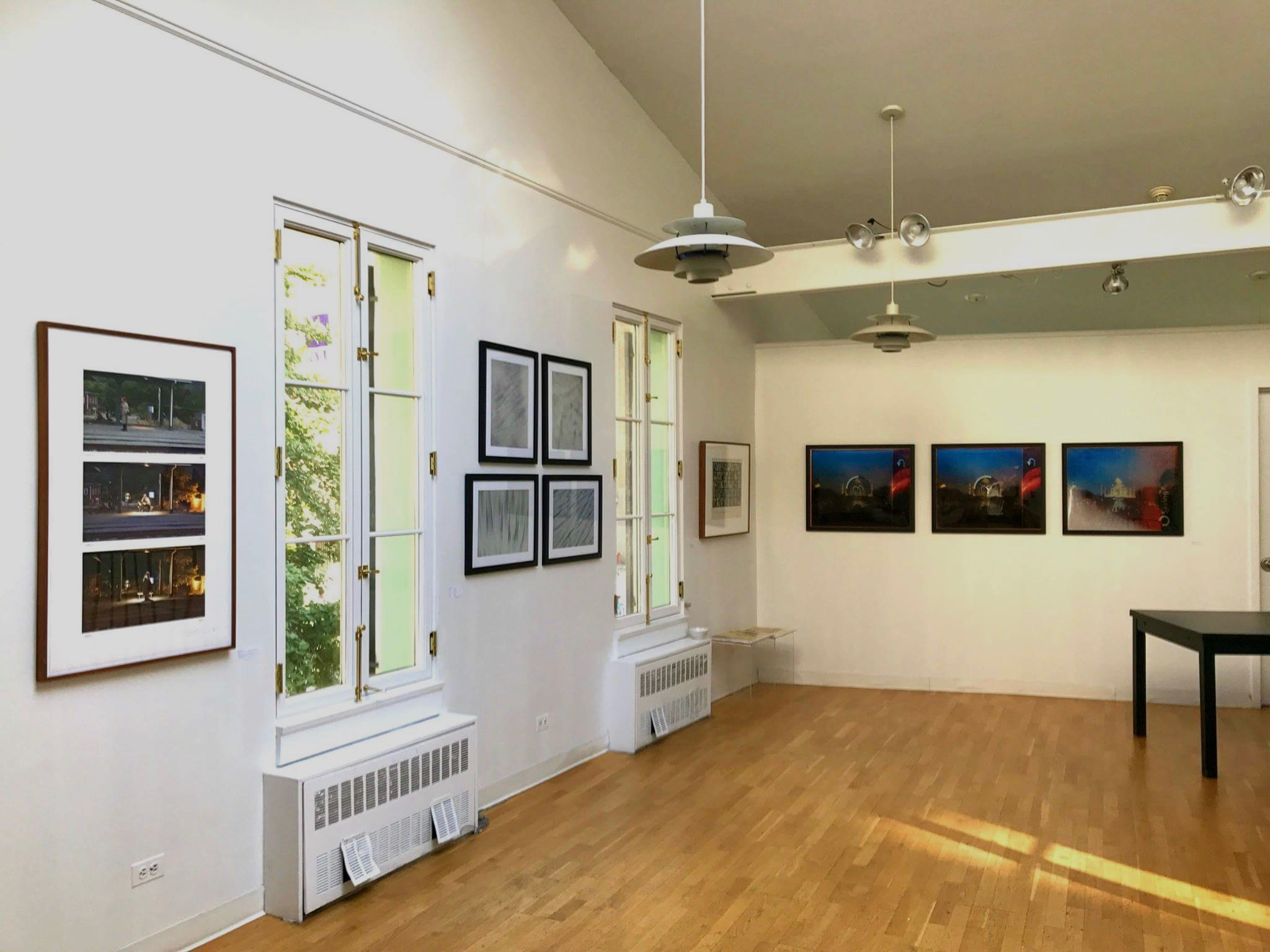 "Part of ""Measuring Time"" at NYU's Deutsches Haus with  Littoral  photos in the middle (between the windows). My  de-composition  photos are on another wall."