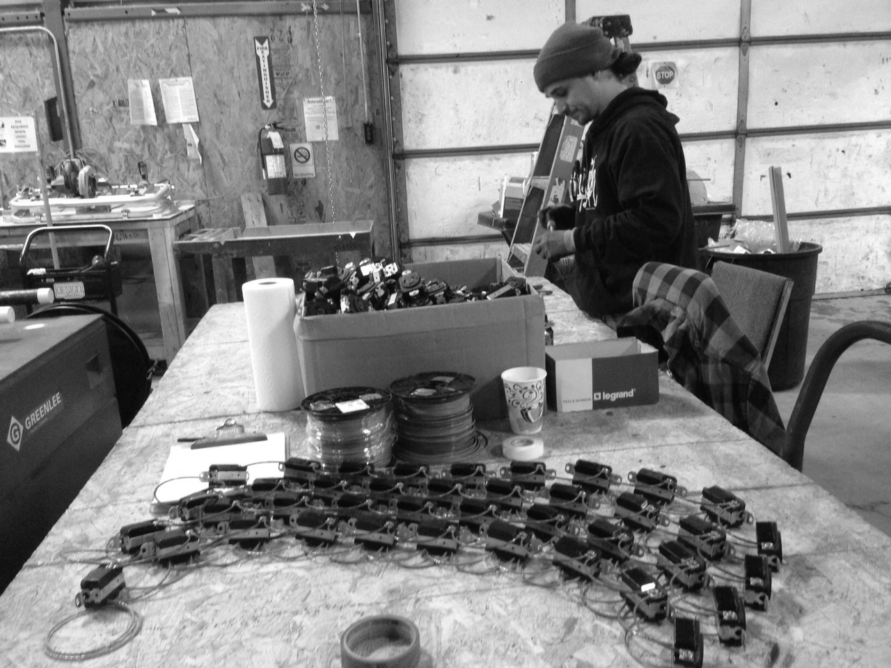 Dustin Spitler puts together some of the 4,740 receptacle assemblies that were prefabricated for this job to provide circuits for lighting the growing racks.