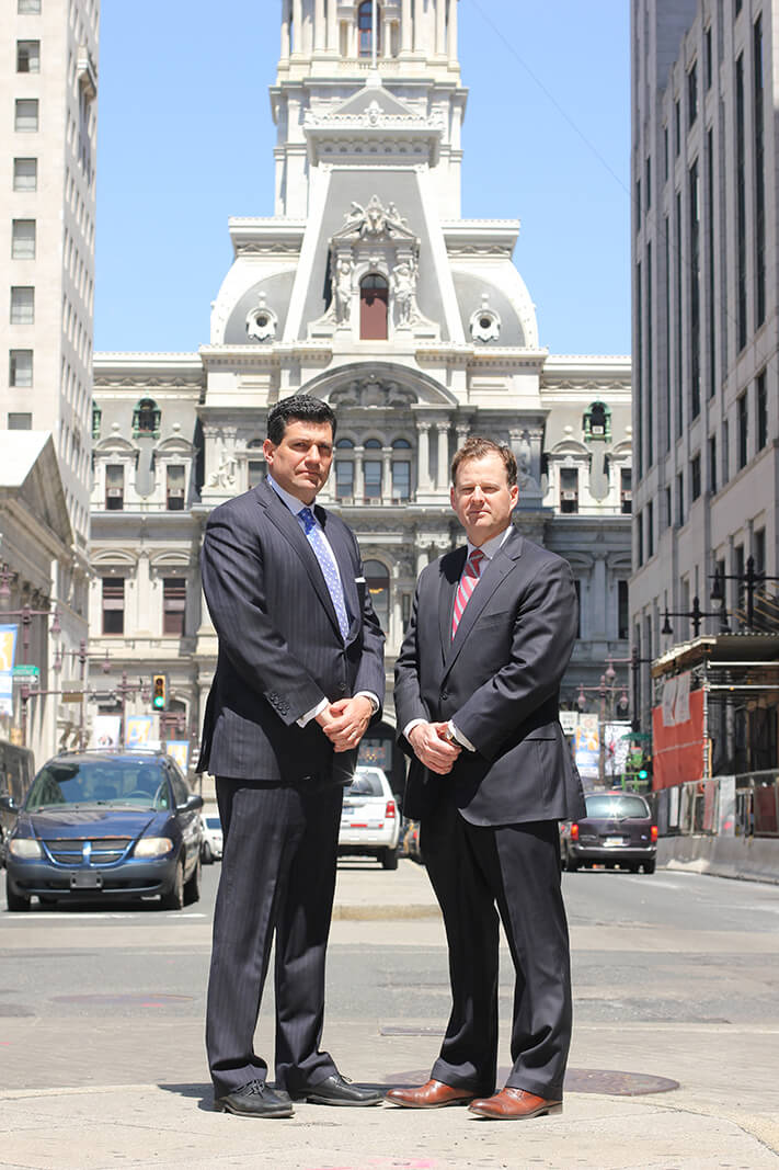 Criminal defense lawyers Josh Scarpello and Pierre LaTour Standing on the street.