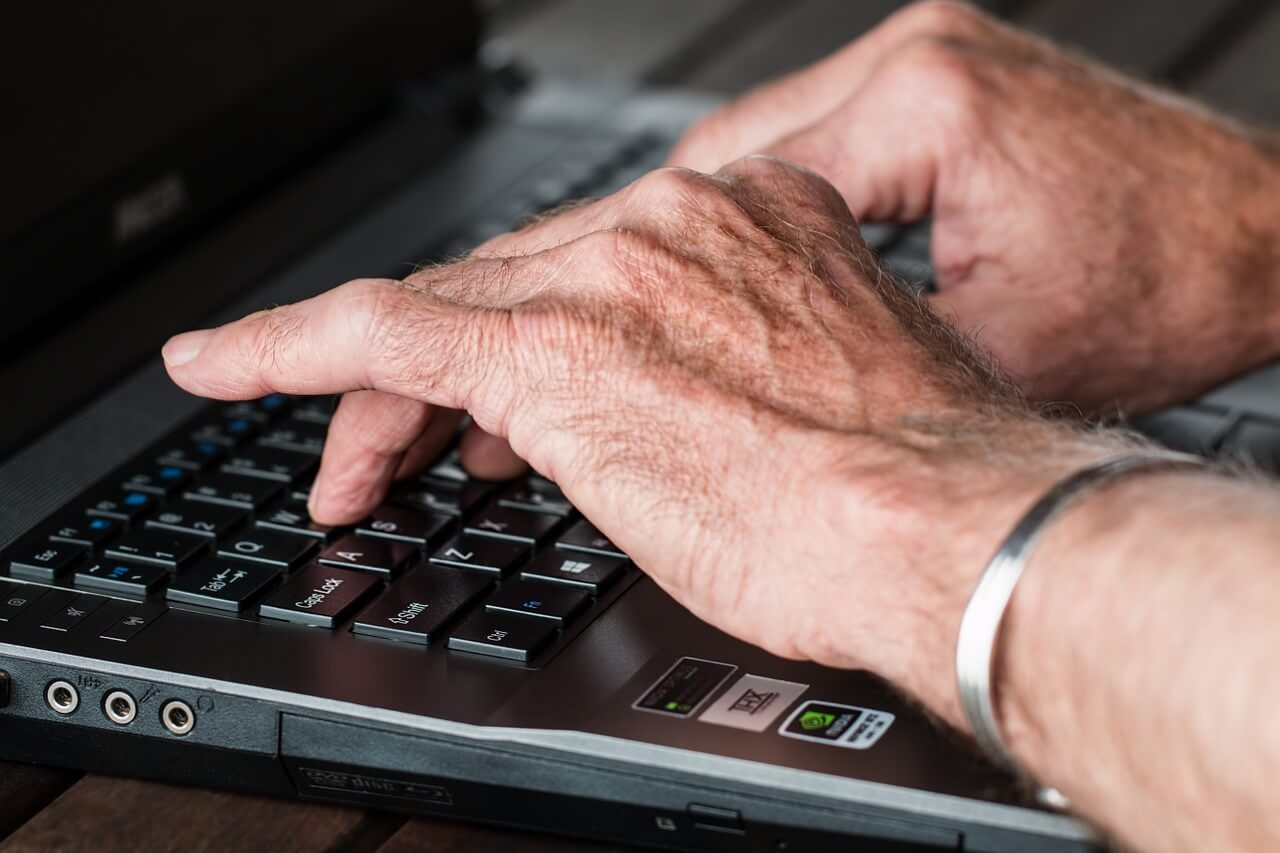 A man typing on a computer keyboard.