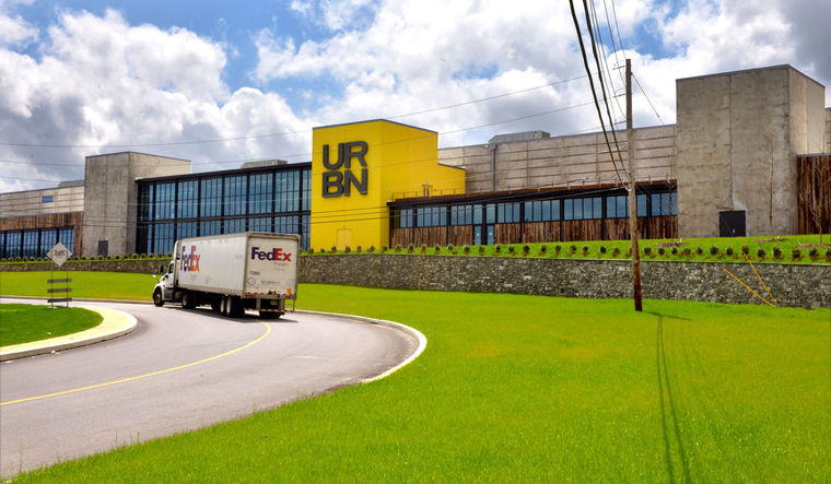 Curving driveway leads to URBN Internet Fulfillment Center, designed in collaboration with NewStudio Architecture
