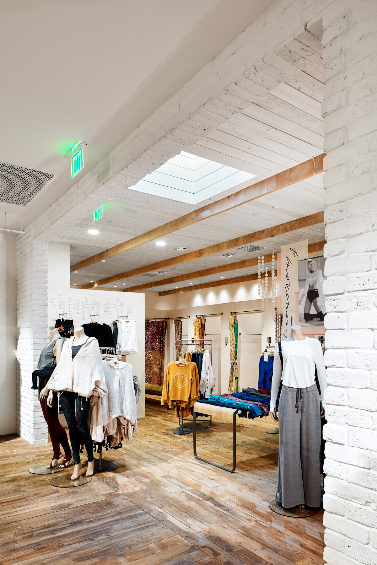 Interior design features whitewashed walls at Free People in Edina, Minnesota, created in collaboration with NewStudio Architecture