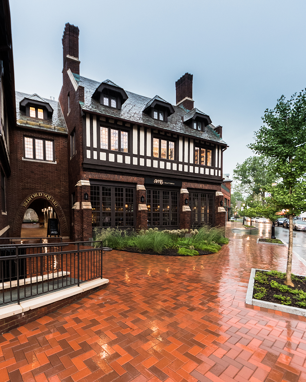 Tudor-style mansion adaptive reuse project for Anthropologie & Co. at Bedford Square, by NewStudio Architecture