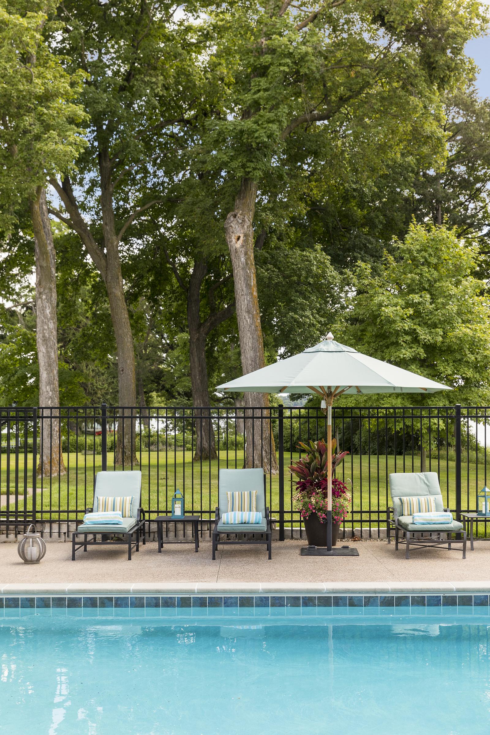 Pool area designed by NewStudio Architecture complements landscape design
