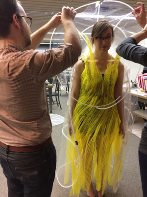 The NewStudio Architecture team begins work on the cape for the IIDA Fusion + Fashion fundraiser