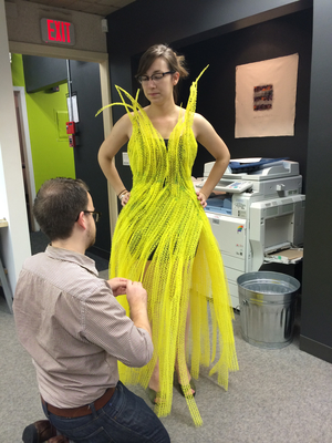 NewStudio Architecture staff members create a polymer-mat dress for the IIDA Fusion + Fashion fundraiser