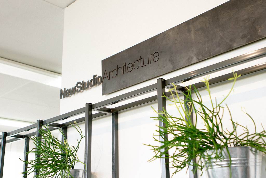 Live plant wall interior design by NewStudio Architecture for its former White Bear Lake office
