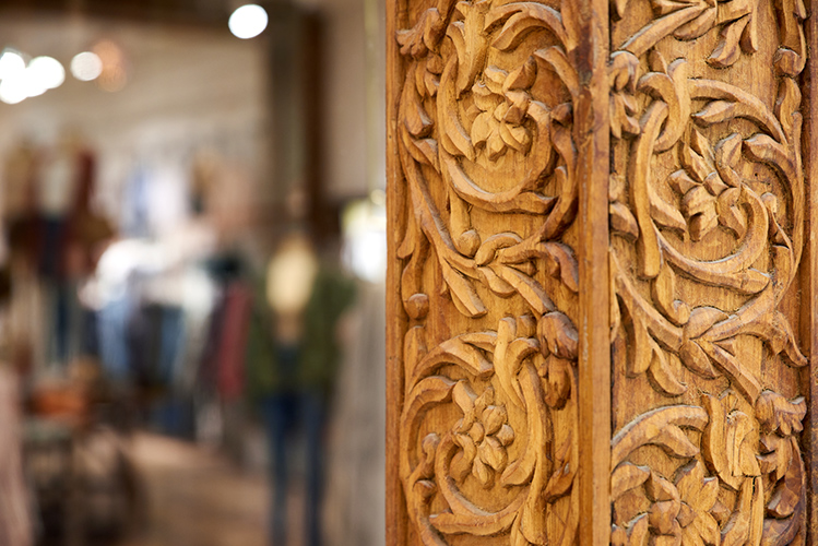 Close-up of hand-carved teak at Free People in MOA, created in collaboration with NewStudio Architecture
