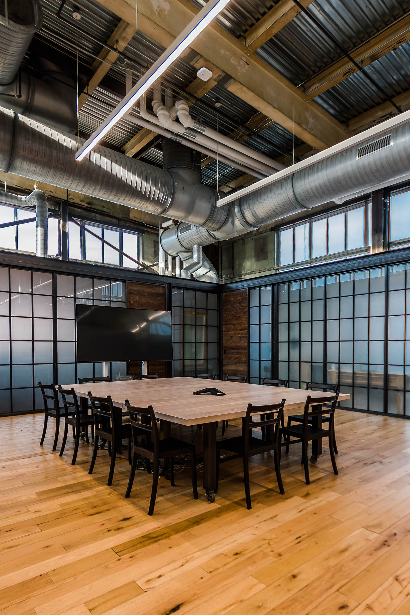 NewStudio Architecture collaborated with URBN to design the Terrain meeting area in the adaptive reuse of the Navy Yard Building 18 Annex