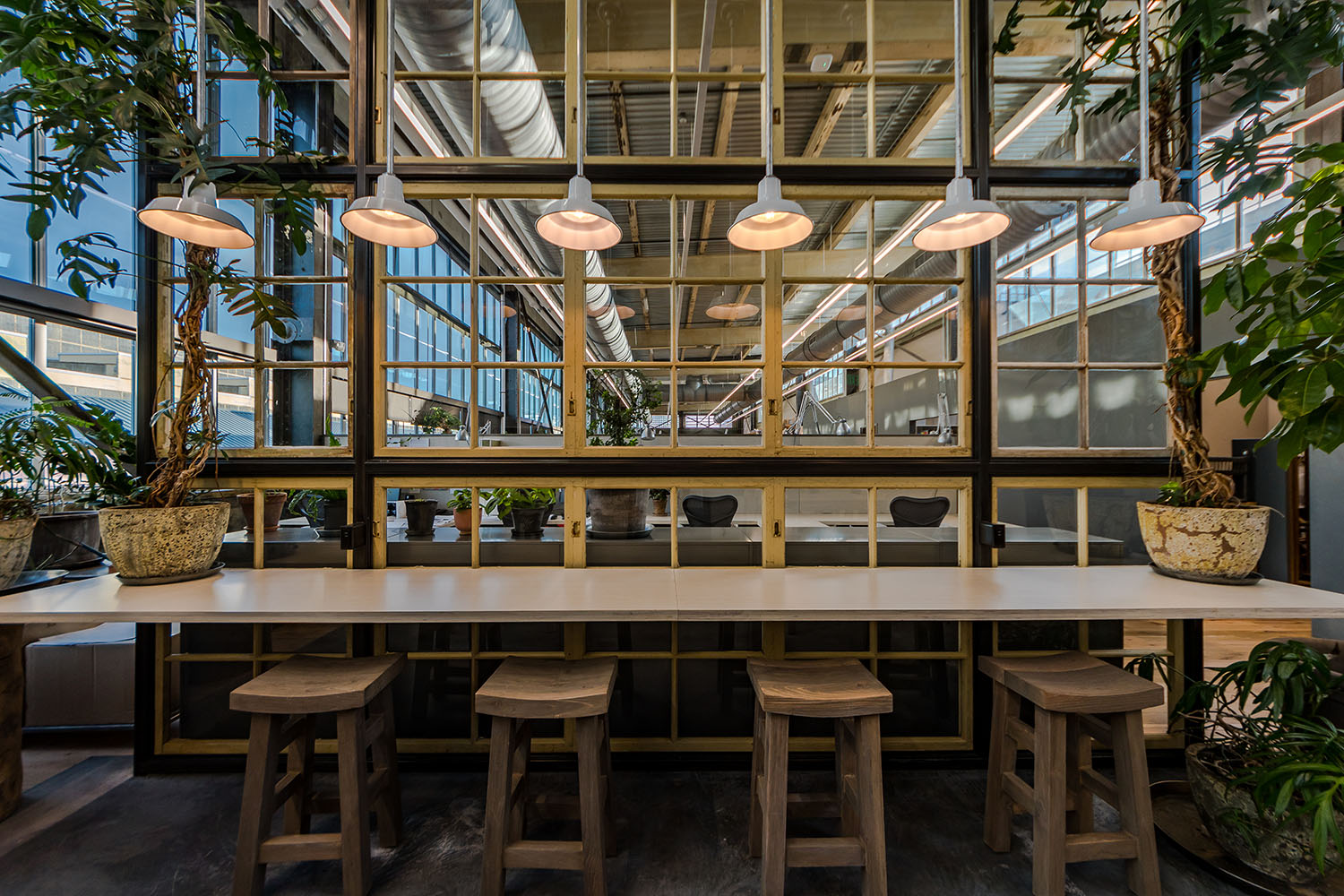 NewStudio Architecture collaborated with URBN to design Navy Yard Building 18 Annex with light-filled workspaces for Terrain staff