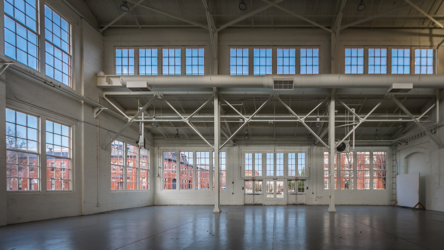 Philadelphia Navy Yard, Building 3, features multi-panel windows on two levels for this well-lit interior; designed in collaboration with NewStudio Architecture