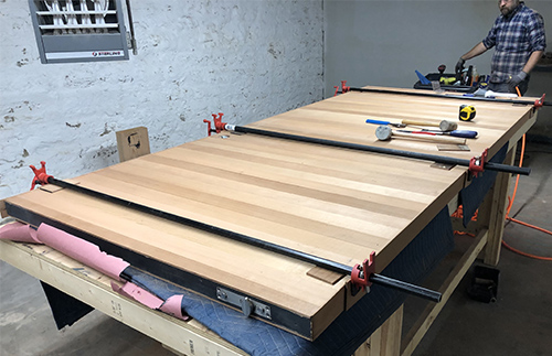"""Redwood slats are laminated to edge faces of """"Frits"""". Once the glue is set, we hang a door!"""