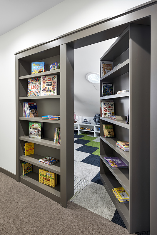 The Lego Room is tucked away behind a bookshelf door.