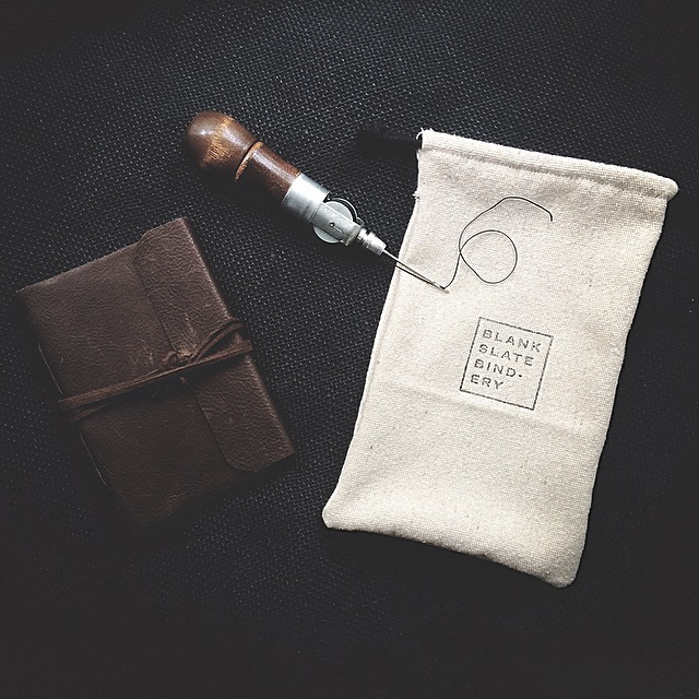 Sparing no expense for packaging the journals with custom hand stamped linen drawstring bags. This also means learning how to sew. (Thanks mom!)