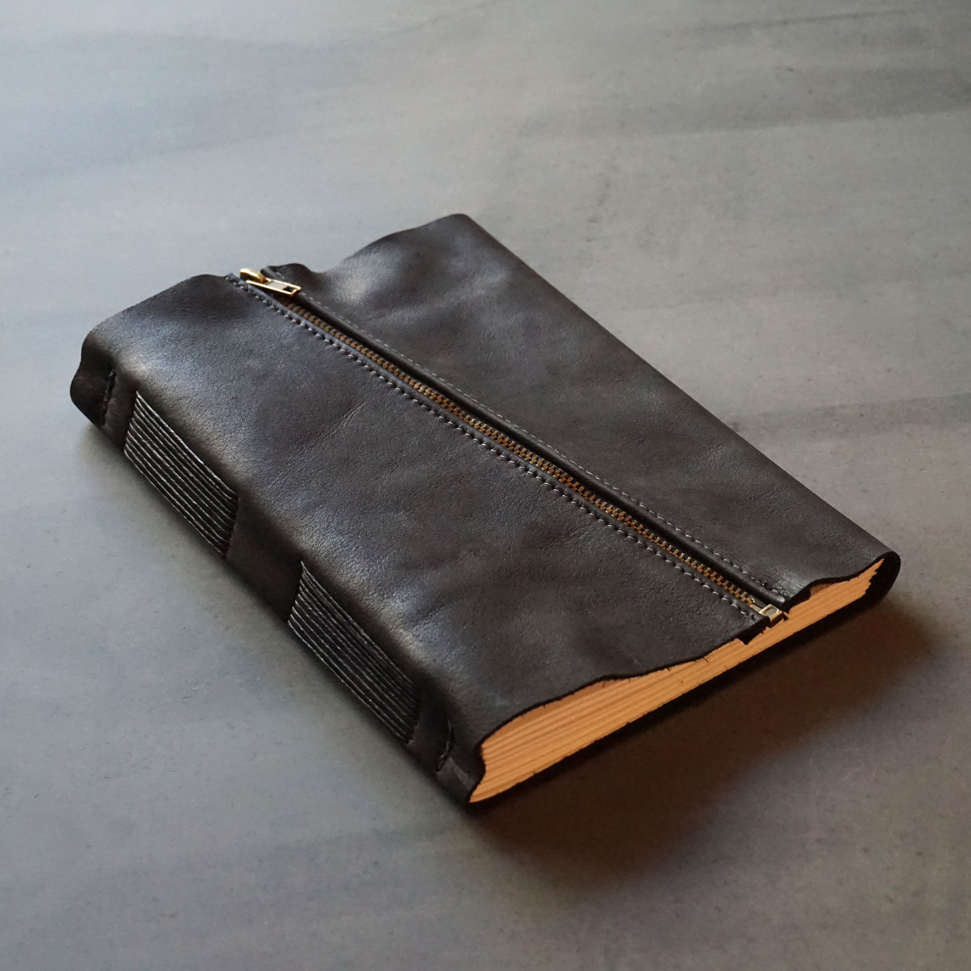 This journal has a rugged approach with its black buffalo hide and antique brass zip closure