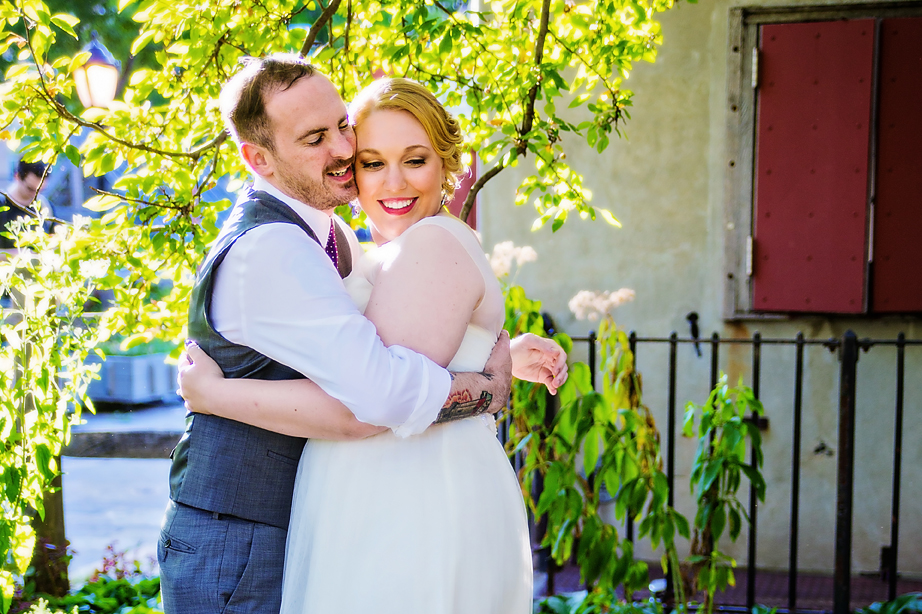 Offbeat bride and groom hug during golden hour first look - Luxe By Lindsay Photography, South Carolina