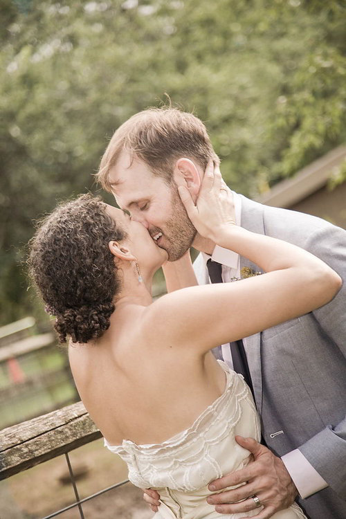 Bride and groom kiss in Queens County Farm Museum, NY - Luxe By Lindsay Photography - Charleston, South Carolina