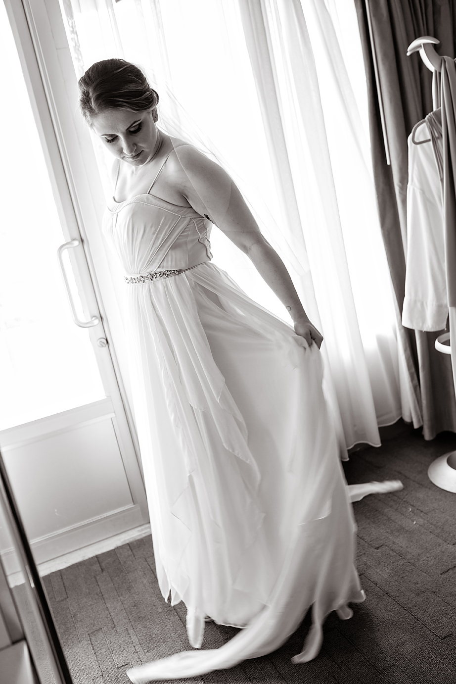 Black and white portrait of bride twirling in her wedding dress - Luxe By Lindsay Photography - Charleston, South Carolina