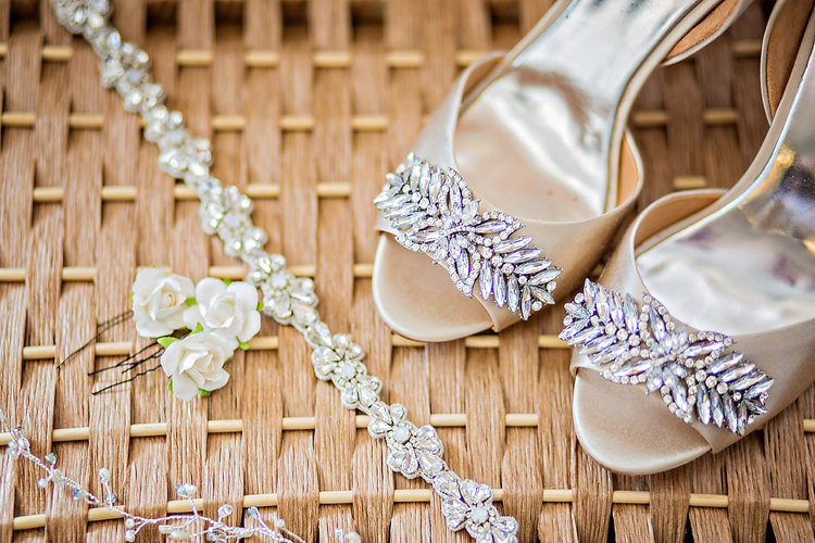 Bridal details of Badgley-Miscka jewel wedding shoes, belt, and flower hairpins on basket background - Luxe By Lindsay Photography, Charleston, South Carolina