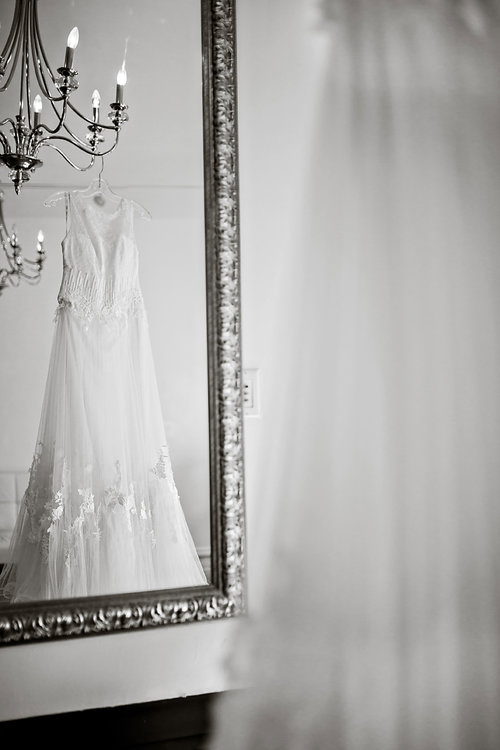 luxe-by-lindsay-charleston-south-carolina-sc-lowcountry-wedding-photographer-hanging-wedding-dress-mirror.jpg