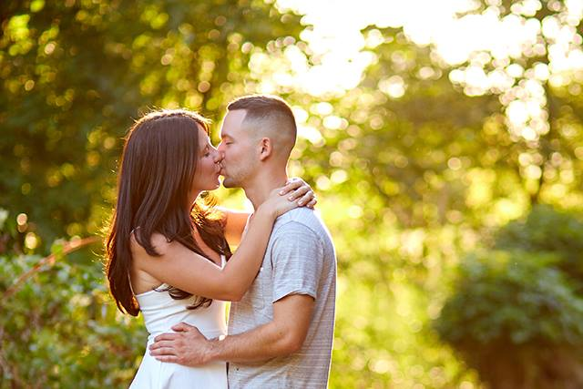Couple kiss during golden hour engagement session South Carolina