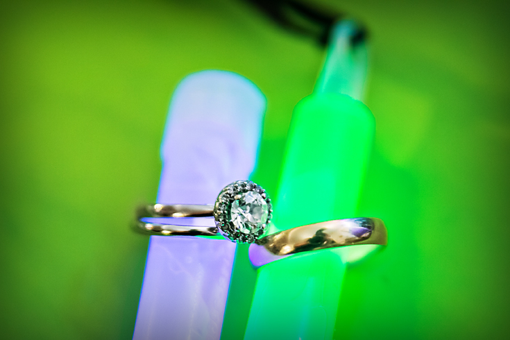 Fun detail of engagement and wedding rings on glowticks - Luxe By Lindsay Photography - Charleston, South Carolina