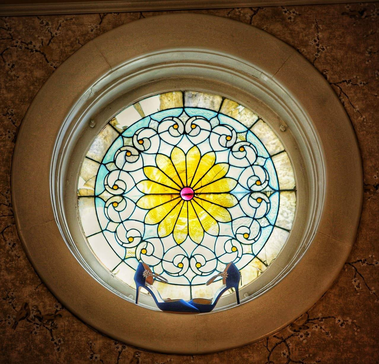 Blue high heels in the stained glass window at Gastonian Inn, in Savannah, Georgia.