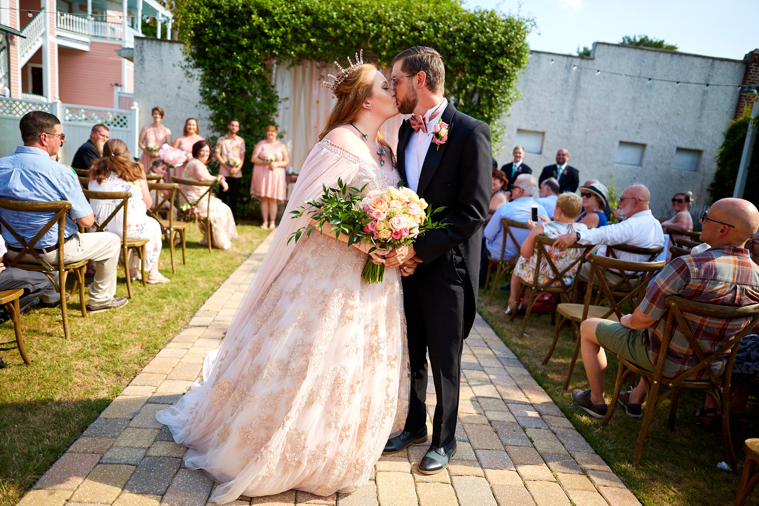 Whimsical, offbeat bride and groom kiss after their Tabbey Garden wedding ceremony, at the Beaufort Inn, in Beaufort, South Carolina.