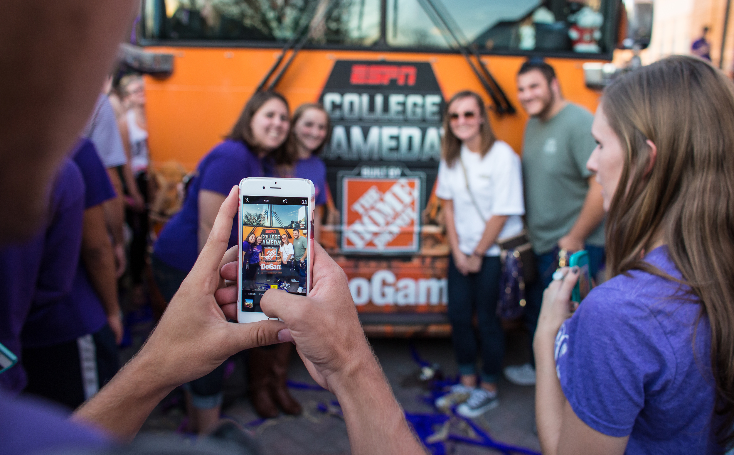 JMU students pose for a photo in front of the ESPN College GameDay bus.