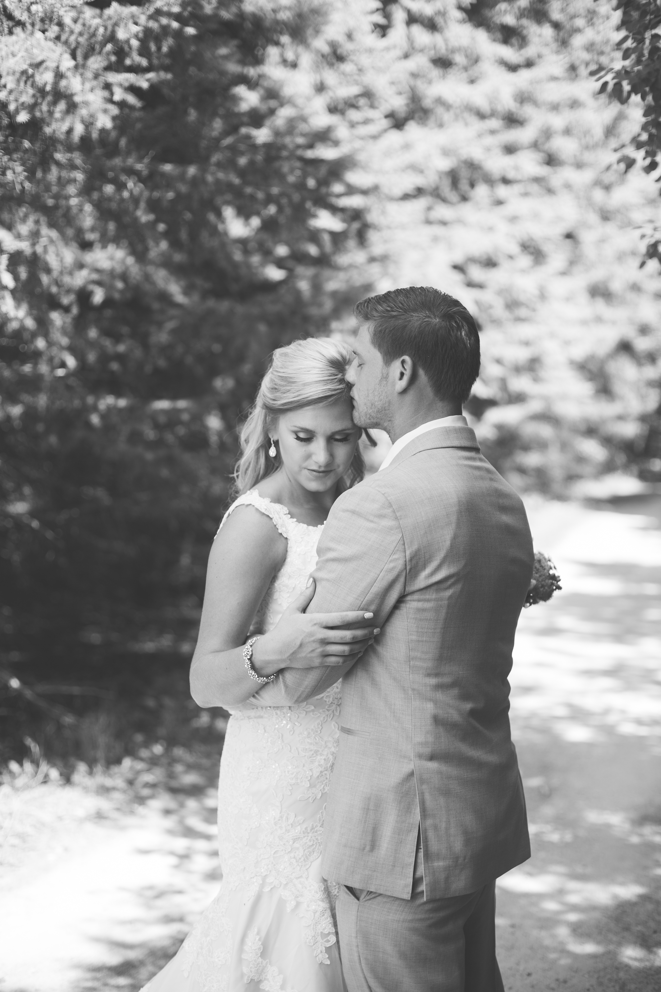 Bride and groom embracing in black and white portrait for wedding at Echo Valley in Wisconsin