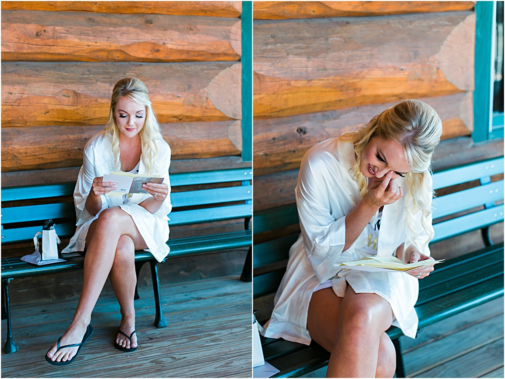 Minnesota summer wedding bride reading card and opening gift from groom in heartfelt moment