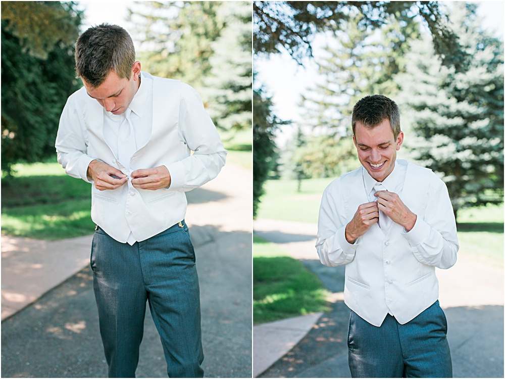 Groom getting ready for Minnesota summer wedding day in dark gray suit and white vest