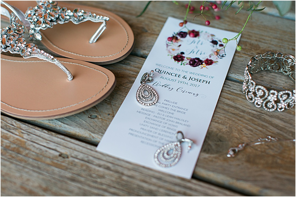 Minnesota summer wedding photo showing invitation, jewelry and shoes