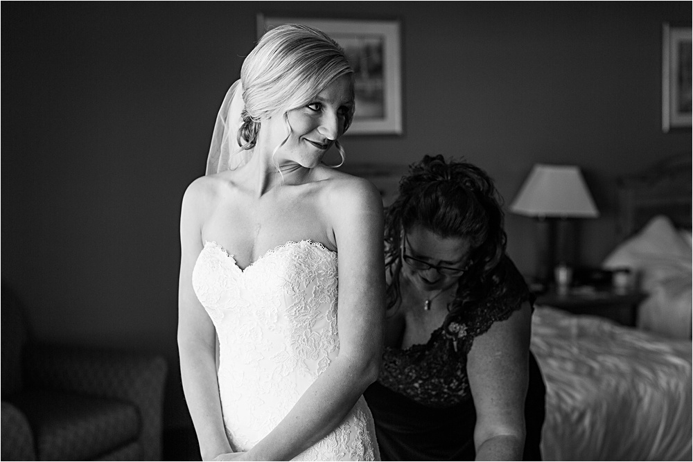 Bride getting ready with mom in black and white photo at Minnesota summer wedding