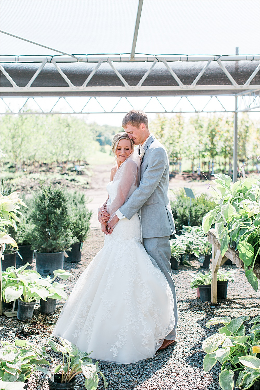 Bride and groom portrait outside at Minnesota summer wedding in Buffalo MN photographed by Mallory Kiesow, Minnesota wedding photographer