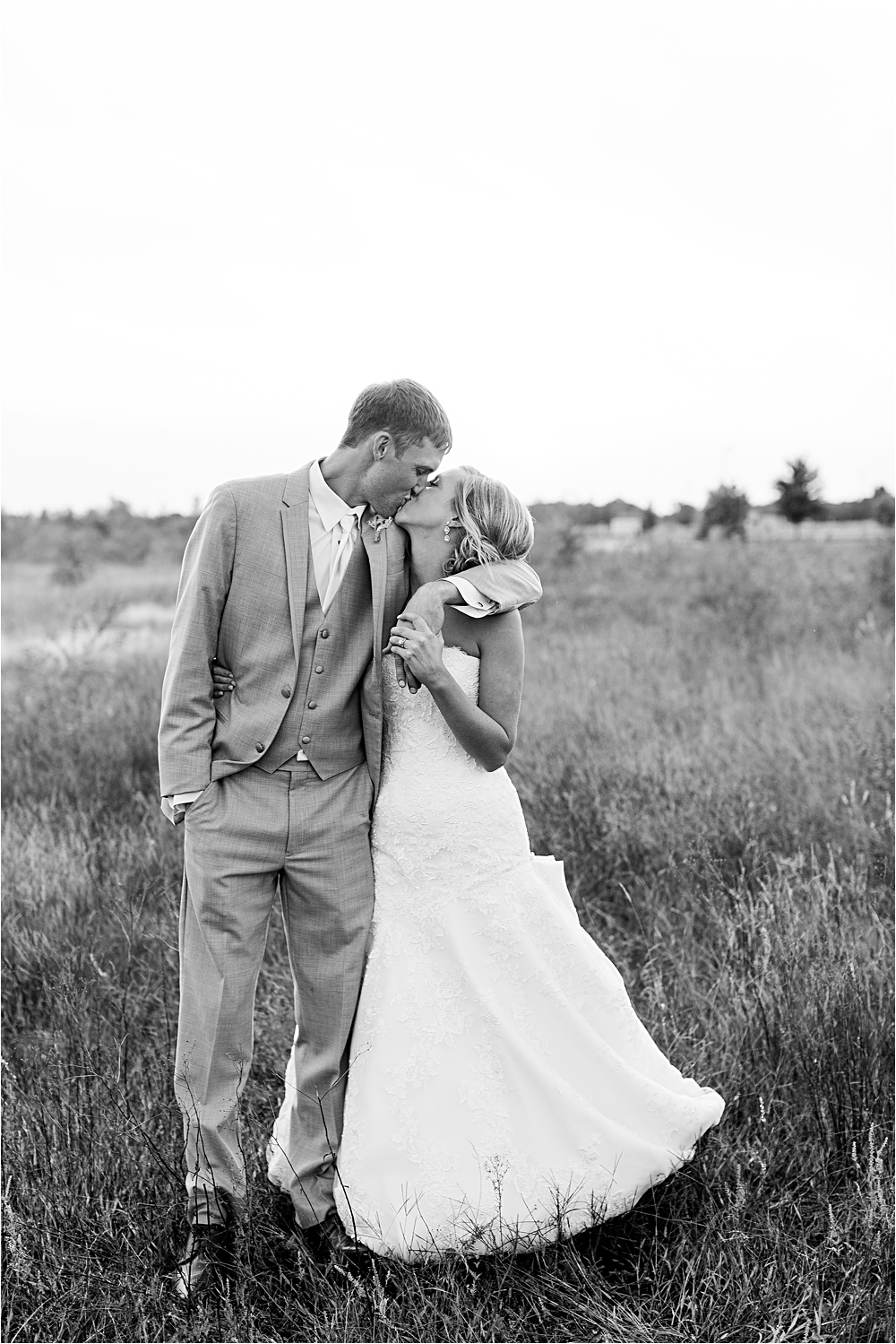 Bride and groom sunset portrait outside in field at Minnesota summer wedding in Buffalo MN photographed by Mallory Kiesow, Minnesota wedding photographer