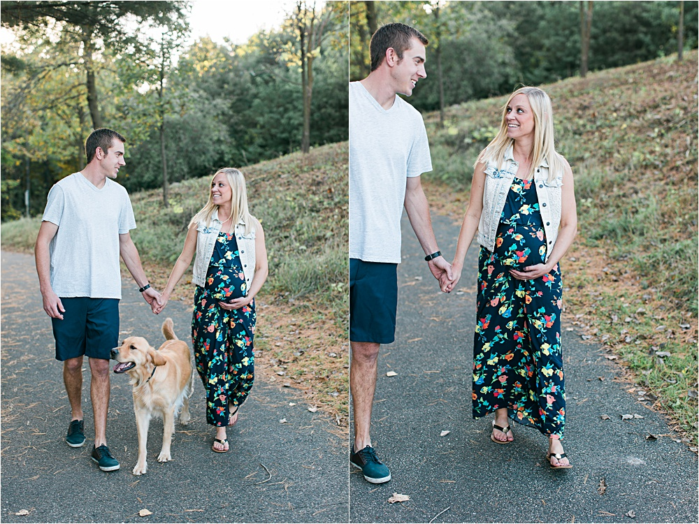 Couple and dog walking for Minnesota fall maternity photos