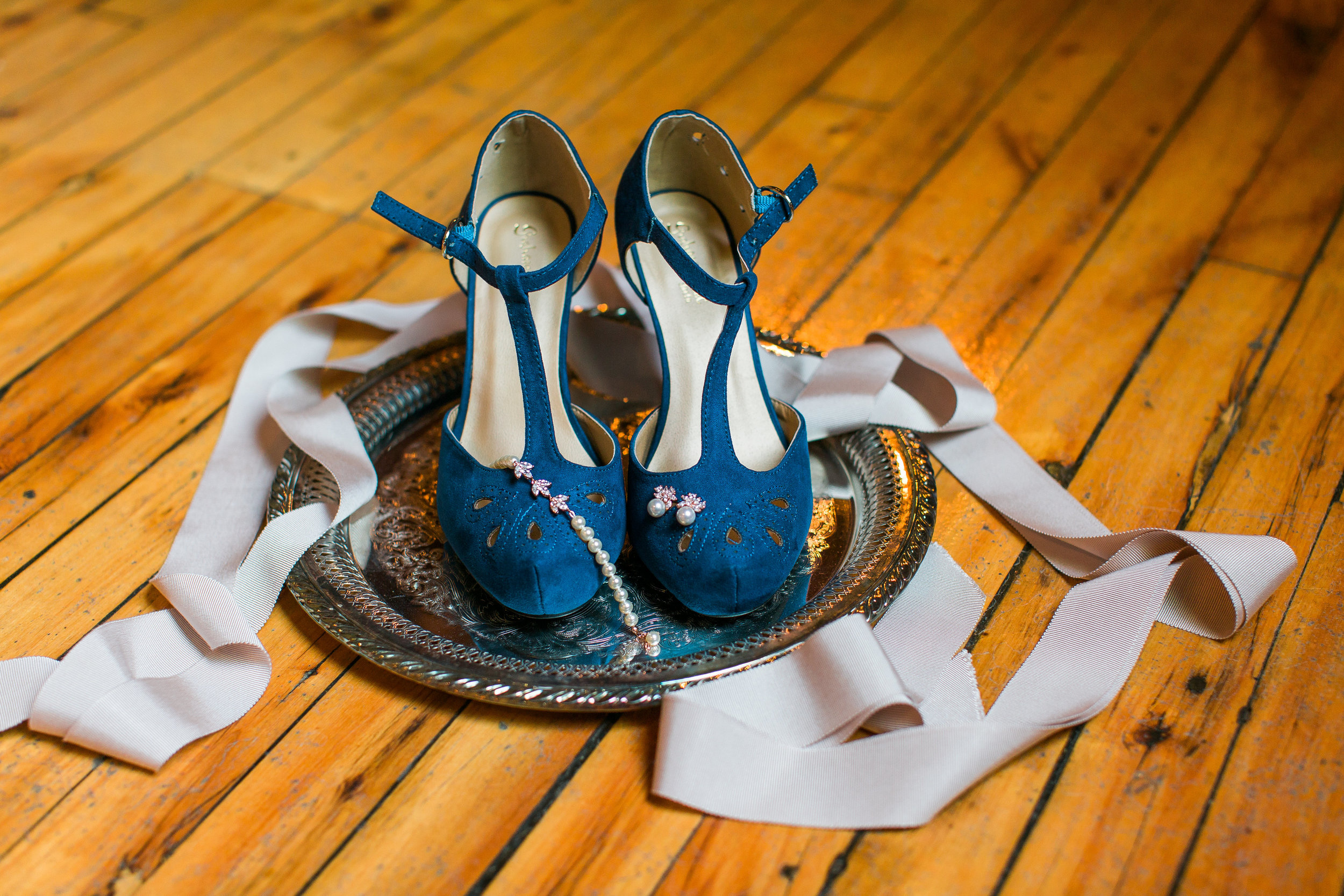 Wedding photography details bride's blue shoes with jewelry Minneapolis Event Centers Wedding