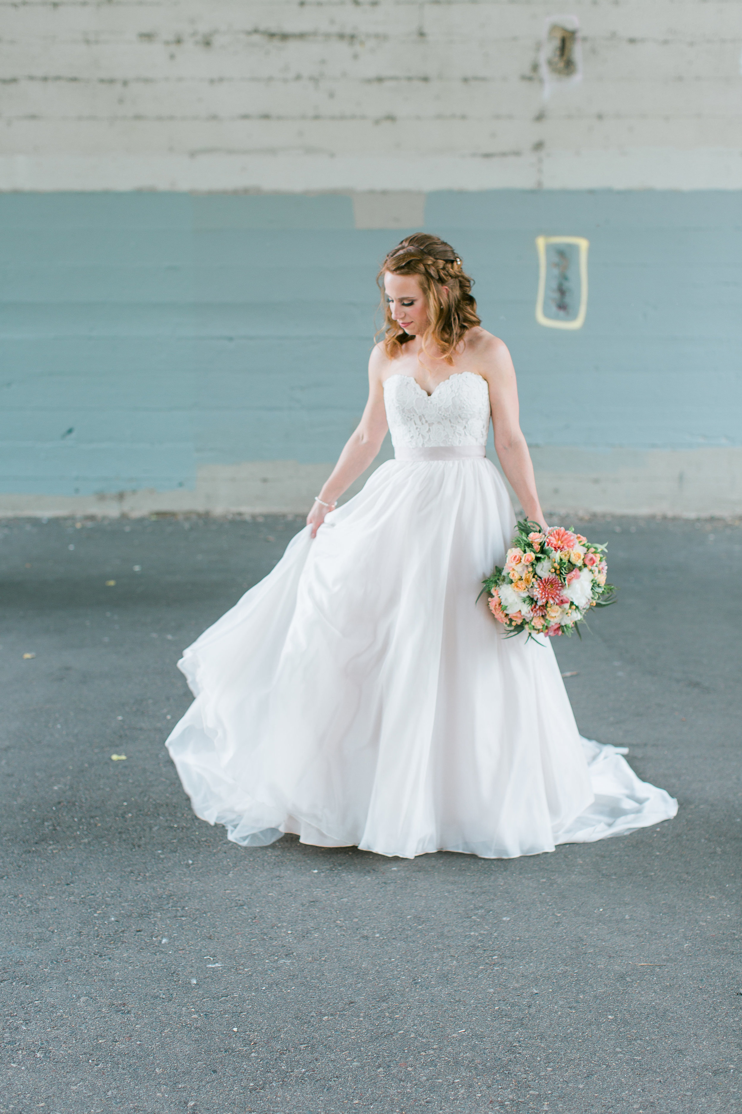 Bride with flowy Essence of Australia wedding dress in urban city setting in St. Anthony Main at Minneapolis Event Centers Wedding