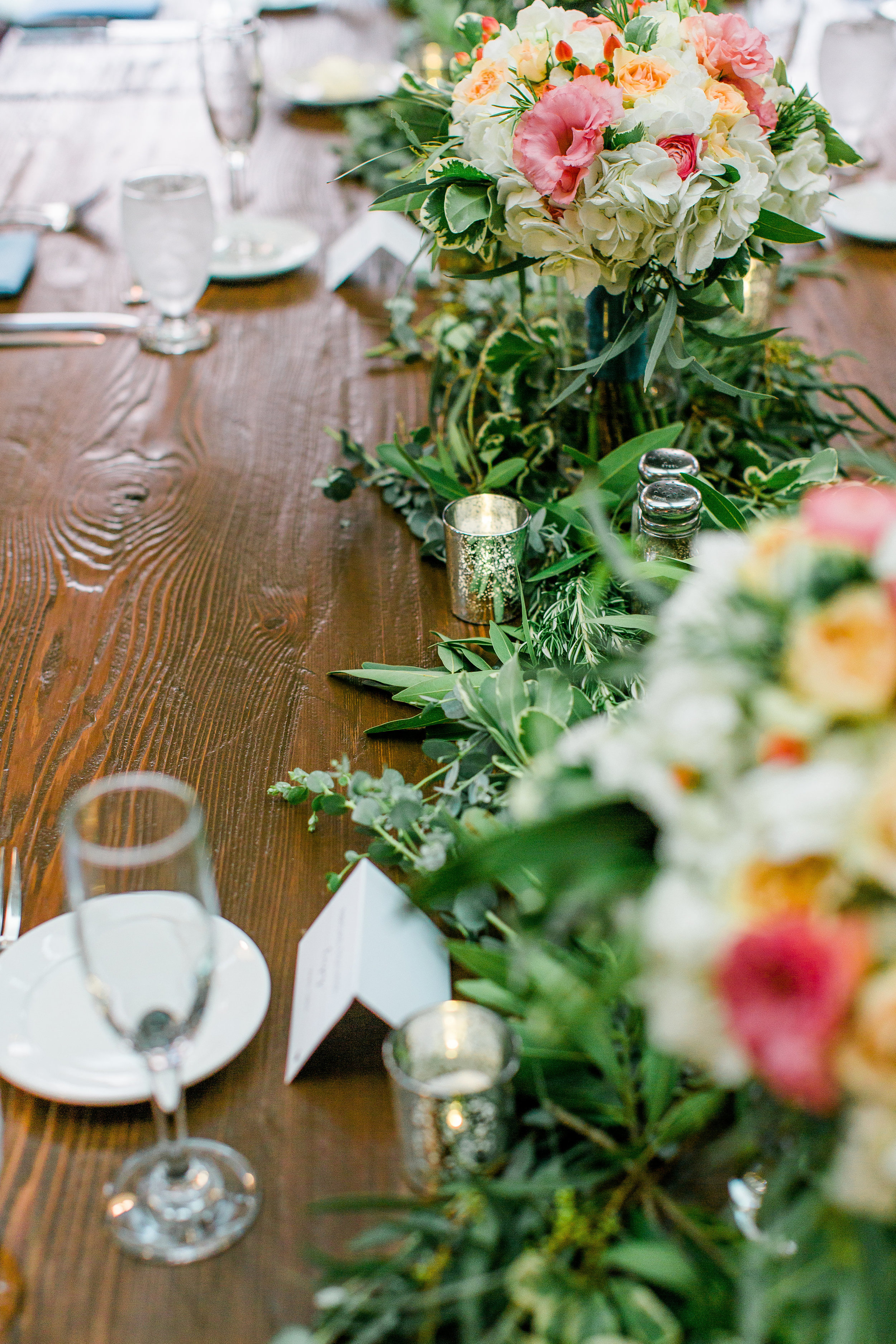 Wedding centerpiece floral greenery tablescape at Minneapolis Event Centers wedding rustic charm