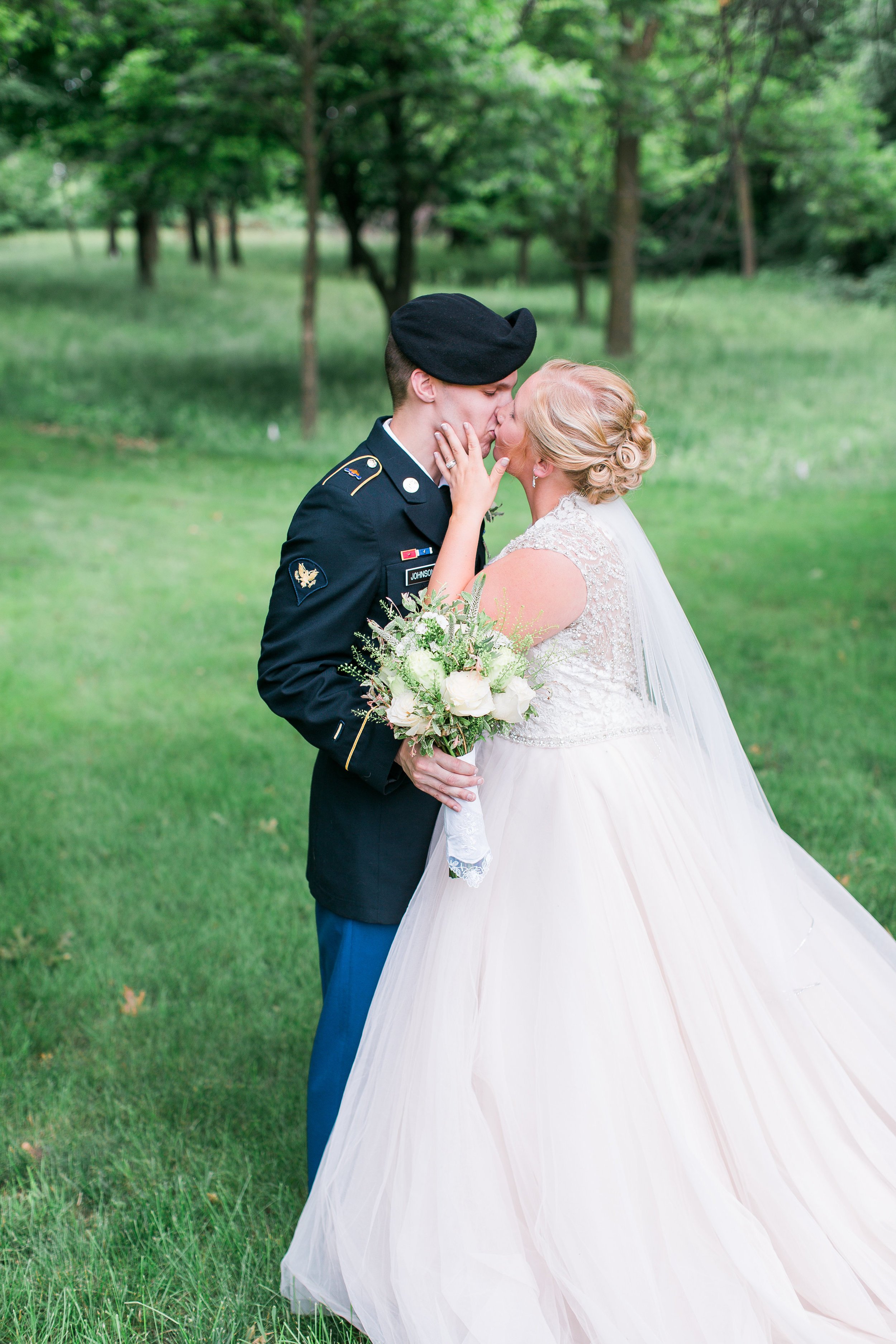 Military wedding bride and groom kissing during summer wedding in Minnesota