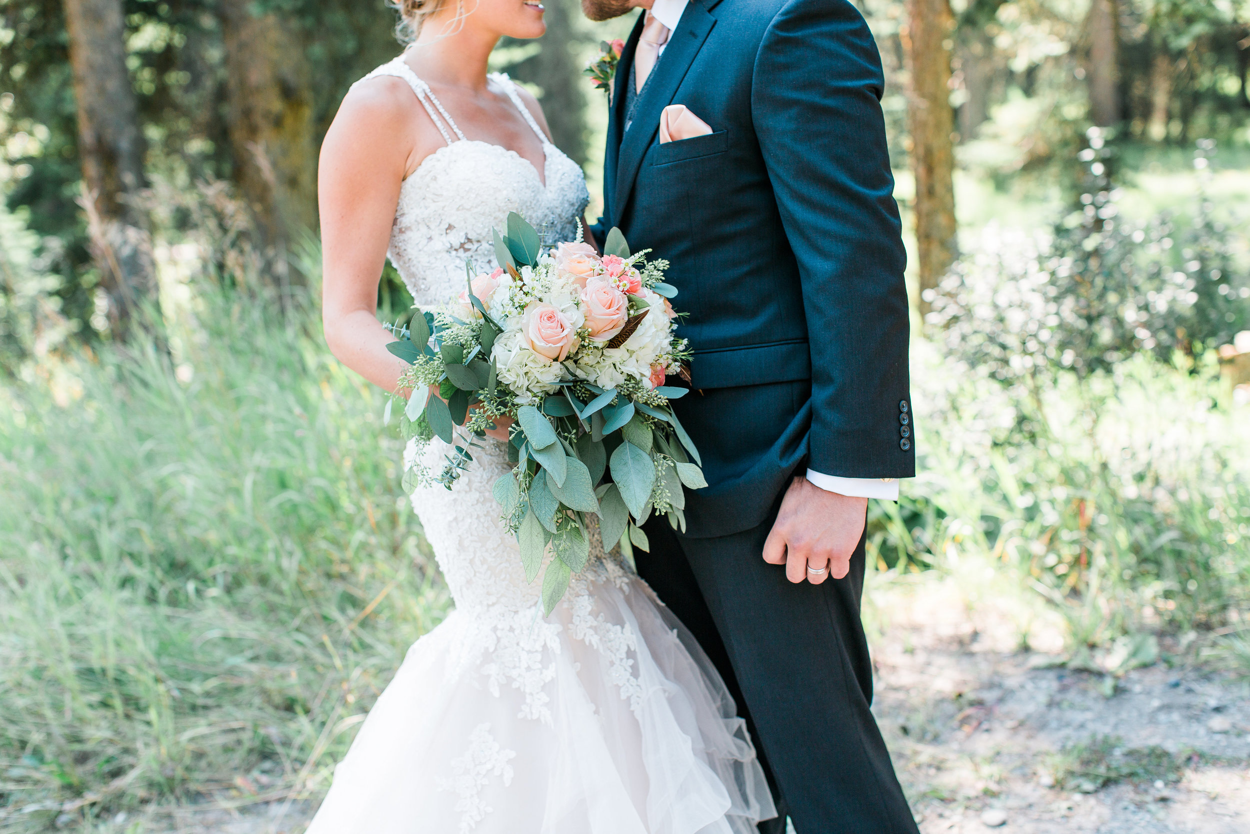 Bride and groom details with bouquet in Big Sky Montana wedding at Lone Mountain Ranch