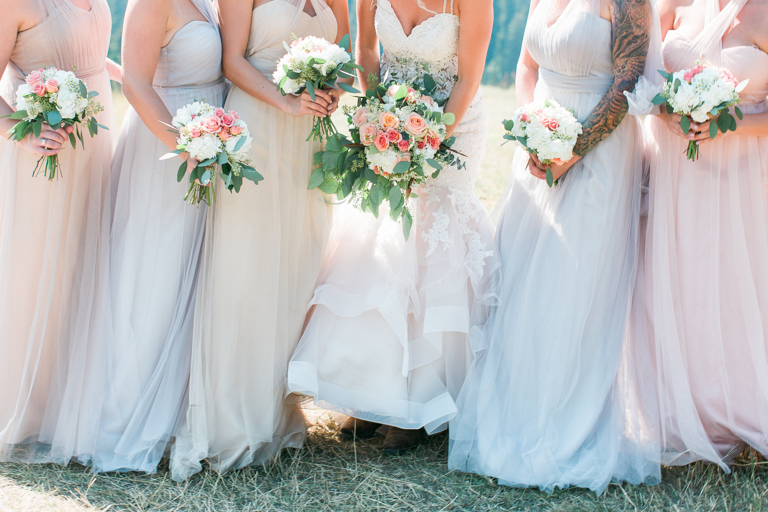 Flowy bridesmaid dresses at Big Sky Montana wedding at Lone Mountain Ranch with bridesmaid bouquets