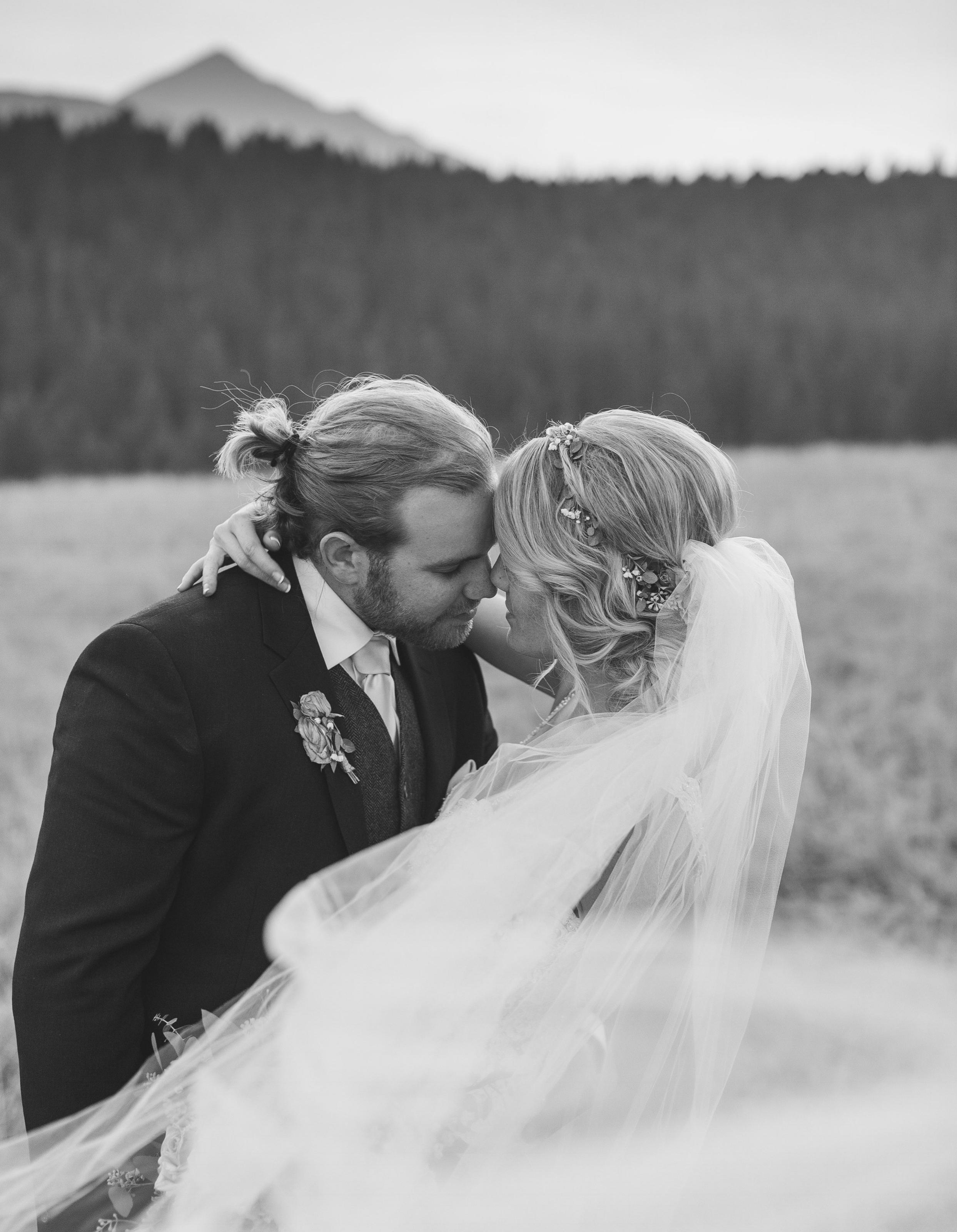 Big Sky Montana wedding bride and groom with mountains