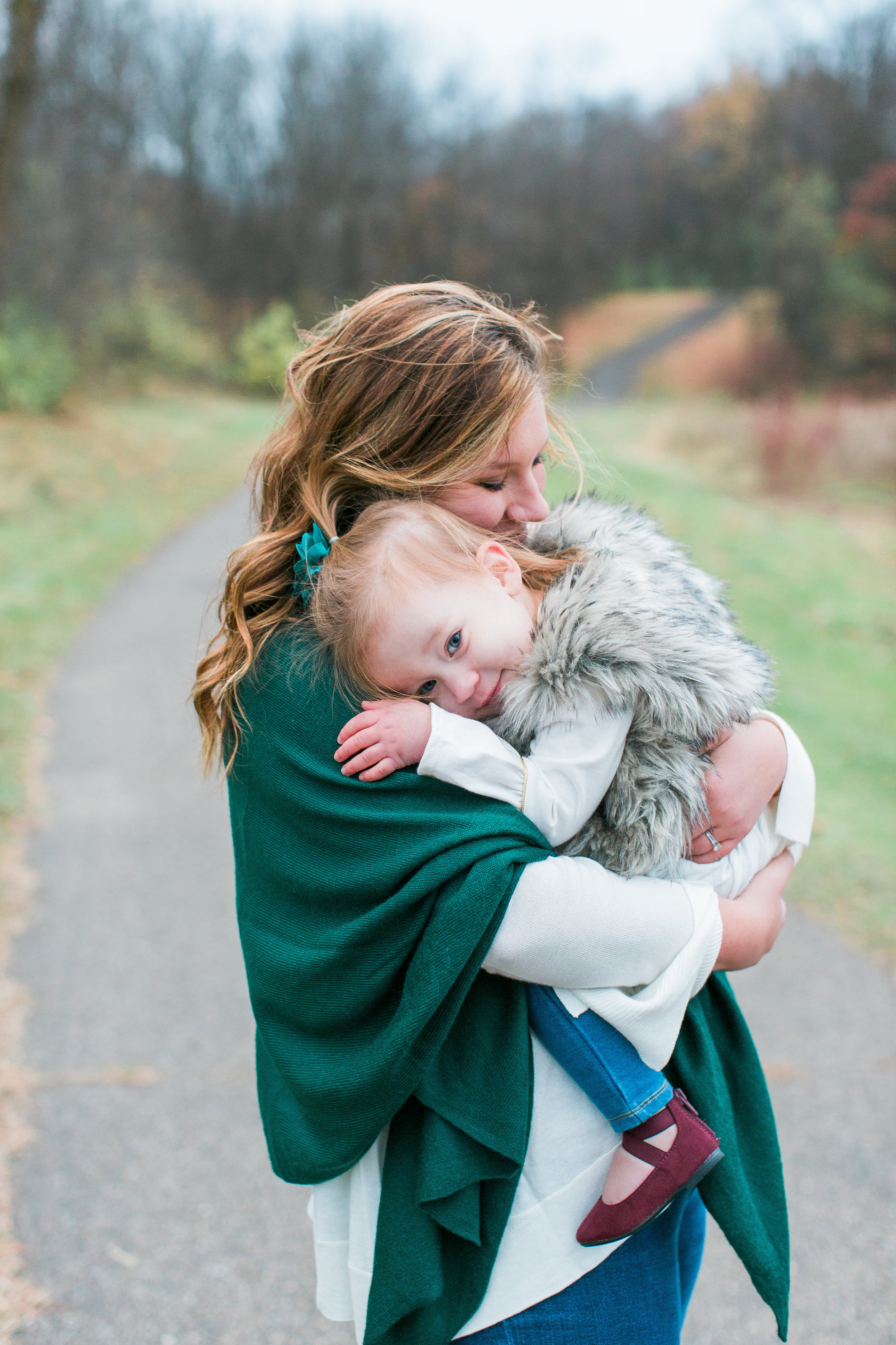 Mom and toddler hugging in lifestyle Minnesota family photo Minnesota family photographer Mallory Kiesow Photography