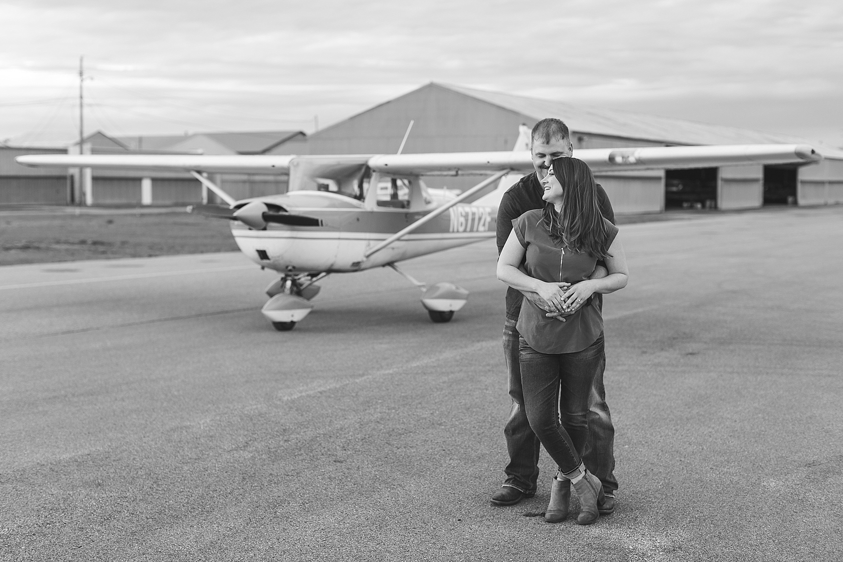 Minnesota airplane engagement session flying cloud airport black and white couple in front of airplane