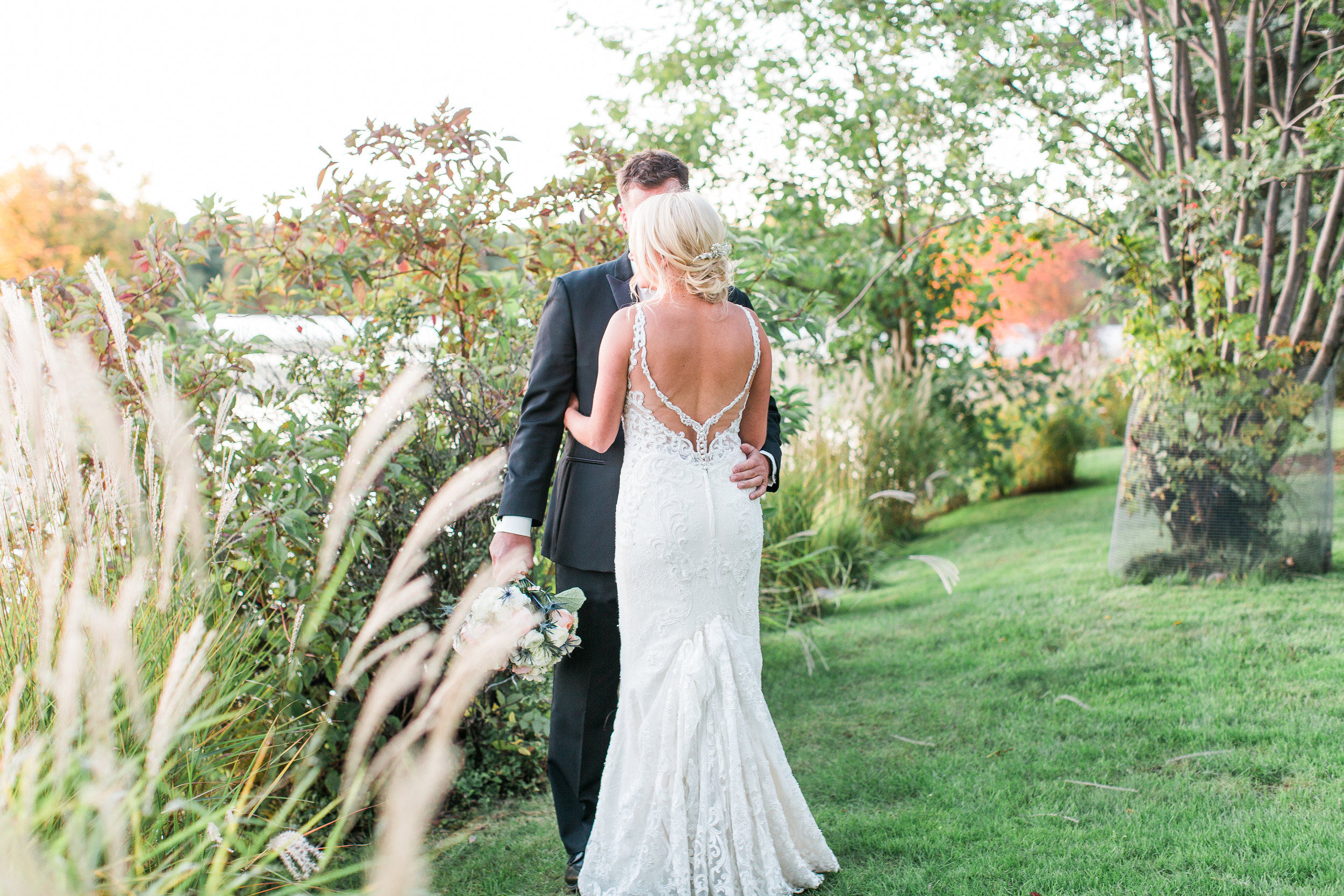 Charthouse Lakeville Minnesota wedding bride and groom at sunset back of dress detail Minnesota wedding photography Mallory Kiesow Photography