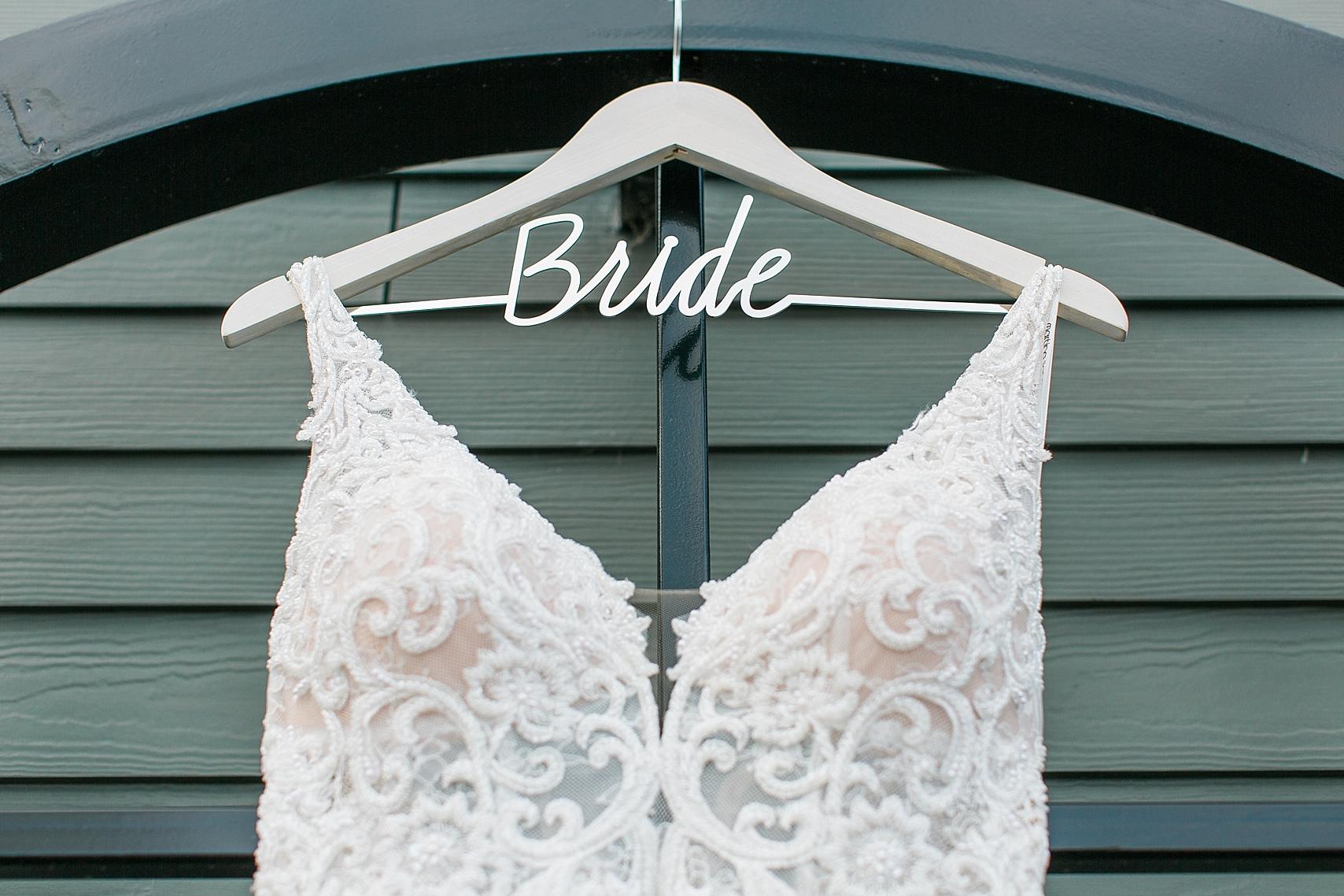 Wedding dress with bride hanger for wedding at the Chart House Summer Wedding Lakeville Minnesota Minneapolis Wedding Photographer Mallory Kiesow